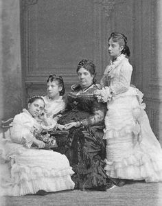 Queen Isabella II of Spain with her three daughters, Infanta Eulalia, Infanta Maria de la Paz and Infanta Isabella.