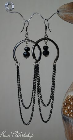 Black earings with crystals and chains.