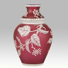 A stunning late 19th Century  cameo glass vase attributed to Thomas Webb, decorated with a crisp white cameo cut floral pattern against a deep red field, exhibiting excellent colour & detail, unsigned.