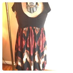 Brown and patterned dress In great condition. One piece dress. Top is brown, bottom is orange, brown and cream swirl print. Capped sleeves. Flows well on. Agb dress Dresses