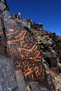 Prehistoric rock carvings. Bayankhongor, Mongolia. https://ExploreTraveler.com