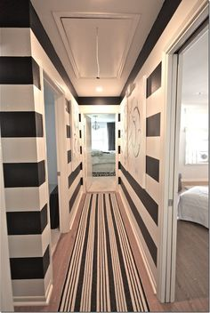 bold stripes add interest to a narrow hallway. Love the walls but wouldn't do the rug too.. It looks like too much to me