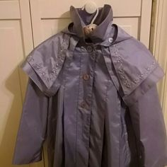 """Rothschild Raincoat.. Childs Lilac Color, with Hood.. (On or off.) Cape collar. (4) Button down coat. The last Button is missing. Embroidered Flower  design on the collar. 26.5"""" (front) 28"""" (back). Rothschild Jackets & Coats"""