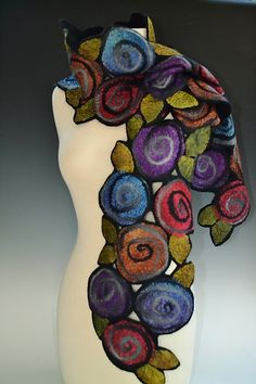 Irene Scarf Silk & Wool Scarf Created by Elizabeth Rubidge. Abstract dyed silk fabric roses and leaves are tossed along a merino wool base. Fine strips of fiber accent and highlight the detail of the flowers while the unexpected use of cut outs create an unusual finish