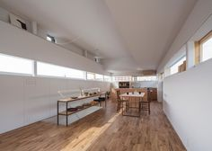 This house in Osaka by Tato Architects features walls stepping back and forth, worktops that merge with staircases, and windows wrapping around entire rooms
