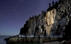 """""""A wall of ice more than 40-feet-high stretches down to the high-tide line on Otter Cliffs overlooking the Atlantic Ocean in this long-exposure photograph taken at Acadia National Park in Maine."""" Caption from link, photo by Robert Bukaty"""