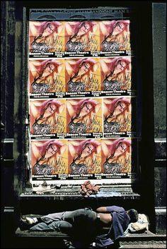 USA, New York: homeless sleeping under Nina Hagen poster. (c) Ferdinando Scianna