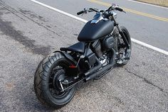 Honda Shadow 750 bobber. I want to do something like this to my shadow eventually. I'm digging the short black pipes and the exposed seat of the bobber look.