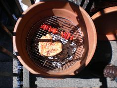 homemade grill using a flower pot.  Pure genius!