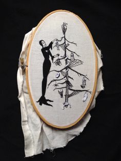 Morticia Addams Xmas embroidery. Based on an Addam's family cartoon. Embroidered by Lillian Ripley