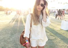 Rumi at Coachella...white outfits ftw! Loving those lace-up shorts too.