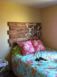 love the white stenciled branches on barnwood headboard
