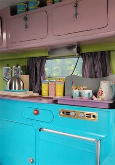 colourful caravan kitchen ---- I love these charming caravan kitchens....