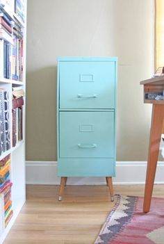 Or, you could give your filing cabinet a lift with a coat of paint and some tapered wooden legs. | 39 Desk DIYs That Won't Feel Like Work