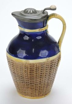 George Jones Basket Weave Lidded Pitcher. Connoisseur Auction