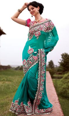 Teal blue saree with blouse. Fabric - Faux Georgette. Work - Bead, lace, resham and stones. To complete the look matching blouse is available with this product. Approx $169.04
