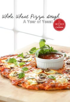 Whole Wheat Pizza Dough via Inspired by Charm #ayearofyeast ...looks delicious!