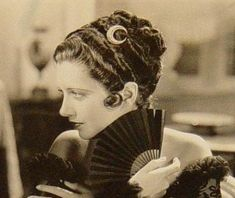 Kay Francis was so cool and elegant (I love the moon hair ornament too.)