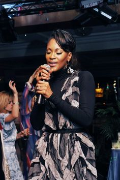 Shontelle performing in a YEOHLEE Musical Bar Bellows dress.