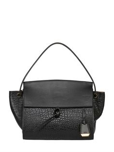 This bag is the perfect black bag. Big enough to fit all of the things I  carry on a daily basis and with a two year old perfect to carry all of ... a1a884b475661