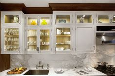 Glass frame cabinetry helps create a brighter and airier space that helps to make your kitchen appear larger.