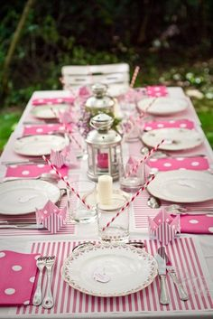 Outdoor table set in pretty pink-and-white dots and stripes