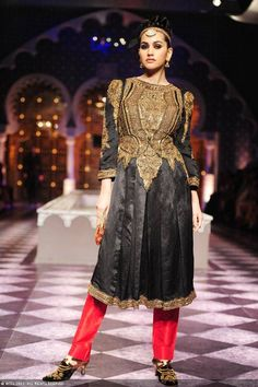 A model displays a creation by designer Raghavendra Rathore on Day 3 of India Bridal Fashion Week in New Delhi on July 25, 2013.