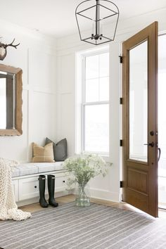 Love this beautiful entryway with a wood front door and transitional decor - entryway ideas - entry - foyer - European farmhouse Beautiful Interiors, Beautiful Homes, Architecture Design, Home Office Space, Shop Interiors, Cabinet Colors, Dining Table Chairs, Entryway Decor, Entryway Ideas