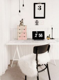 A Faux Marble Desk. Another clever DIY desk. The tabletop with marble printed paper, that is available in hardware stores or online, gives this simple IKEA desk a luxurious look.