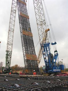 The construction of deep station boxes and shafts on Crossrail has necessitated the re-emergence of diaphragm walling. A diaphragm wall is formed from panels and the wall constructed by digging each panel section in sequence using bentonite slurry to support the excavation. Following excavation, massive reinforcement cages are lifted into place and the slurry is replaced with concrete. Taken from 'The changing face of diaphragm wall cage construction', by Emma Walsh of Byrne Looby.