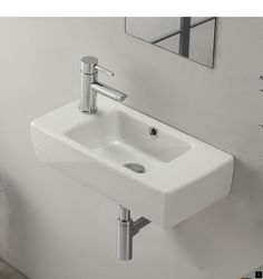 modern, sleek self-rimming or wall mounted bathroom sink. Sink includes one faucet hole on the left side of the sink and an overflow. This beautiful, space saving bathroom sink is made of high-quality white ceramic. Sink is designed by luxury and well Bathroom Layout, Bathroom Colors, Bathroom Interior Design, Bathroom Ideas, Bathroom Makeovers, Remodel Bathroom, Bathroom Remodeling, Colorful Bathroom, Kitchen Makeovers
