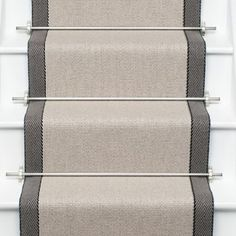 Other couloirs available. Jenna, these are the stair runner rods I mentioned. You could get ghee in antique gold or brass or oil rubbed bronze depending on the hardware finish in your foyer. - Model Home Interior Design