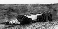 P-47D Thunderbolt of the 367th Fighter Squadron made a belly landing in field artillery position after being hit in the left wing during a dive bombing attack on near Würzburg Germany 1 April 1945. The pilot was only slightly injured.