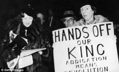 Demonstrators protest against the abdication of King Edward VIII, whose proposed marriage to US socialite and divorcee Wallis Simpson was resisted by Parliament