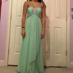 Sea foam green prom dress I wore this 2 years ago during my sophomore year. I went to junior prom. I bought it, wore it for max 5 hours, then took it off and put it back into the bag in the back of my closet. There are no rips or stains. I had it hemmed. I am 5'3 and when I go into my tip toes about 2''-3'' from the floor the bottom is meeting the floor because I wore heels. Let me know if you want specific measurements. I'm typically a 00-0 and it fit me perfectly. $80 ON Ⓜ️ERCARI Dresses…
