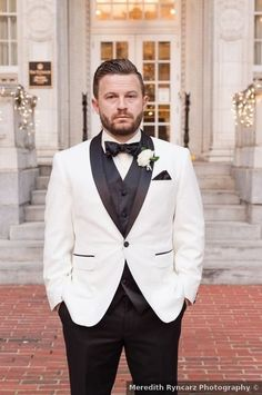 Find wedding inspiration with this Elegant Winter Wedding in Birmingham, AL. Maroon Tuxedo, Green Tuxedo, Pink Tuxedo, Elegant Winter Wedding, Wedding White, Groom And Groomsmen Attire, Groom Outfit, White Rose Boutonniere, Groom Tuxedo Wedding
