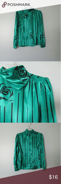 """Vintage Stripes And Roses Blouse Vintage late 70s, early 80s satin blouse in a gorgeous emerald green with a black abstract stripes and roses print. Fabric is 100% polyester. Very good condition with no flaws or signs of wear. Sized a 10. Bust measures 41"""", shoulder to shoulder 15"""", sleeve length 24"""", shoulder to hem 24"""". Vintage Tops Blouses"""