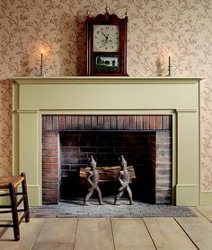 Very simple #fireplace #mantel. Love the color and the #andirons. They are so whimsical.