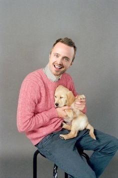 aaron paul. in pink. with a puppy?!? it doesn't get much better than this.