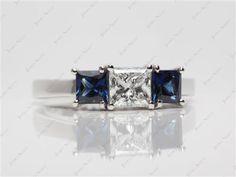 Platinum 3-Stone Princess Cut Blue Sapphire Engagement Ring  with Princess 0.71 Carat F VVS1 Ideal Cut Diamond.