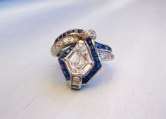 Exquisite 1920's diamond, sapphire and platinum ring that features a gorgeous 2.07 carat kite shaped diamond!