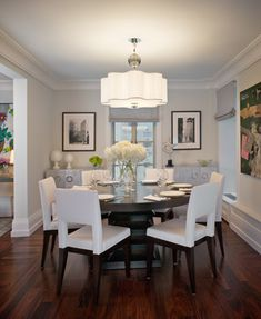 I like an all white dining room with dark floors and table/chairs