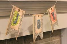 Holiday Banner made from book pages and Hero Arts stamps, etc.