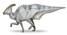 "Charonosaurus (/kəˌroʊnəˈsɔrəs/ kə-roh-nə-sawr-əs; meaning ""Charon's lizard"") is the name of a genus of dinosaur whose fossils were discovered by Godefroit, Zan & Jin in 2000 on the south bank of the Amur River, dividing China from Russia."