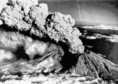 An eruption column rises from Mount St. Helens on July 22, 1980. This was one of a series of explosive eruptions by the volcano in 1980. In the background (right) is the stratovolcano Mount Hood, Oregon. Photo: Bride Lane Library/Popperfoto, Popperfoto/Getty Images / 2013 Popperfoto