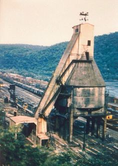 Railroad trackside structures, (reference photos for model railroad). Vintage photography. Coaling tower.