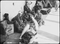American prisoners of war, liberated by U.S. Rangers from Cabanatuan prison camp on Luzon, Philippine Islands, wait for transfer to a base hospital.