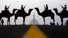 Indian soldiers from the Border Security Forces stood at attention in front of the Presidential Palace. Atop their camels, they prepared for the annual Beating Retreat in New Delhi, India.