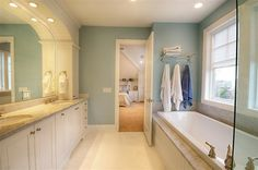 Lovely color for the walls of a bathroom. The recessed lights add for some great lighting too! ♥ Click on this pin to see the rest of the wall colors in this house - every room has a different color!