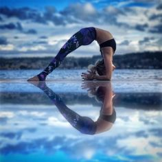 Yoga goals: Forearm wheel, patterned leggings, and a reflection pool full of intention.